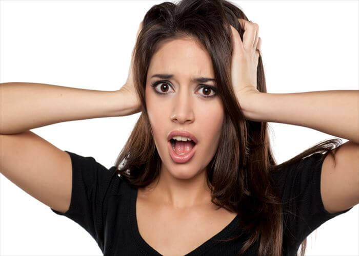 shocked young woman on a white background